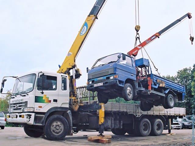 услуги грузового эвакуатора краном манипулятором